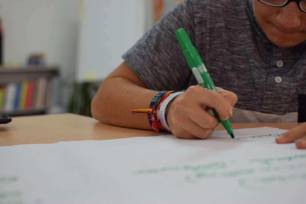 person writing on a white paper