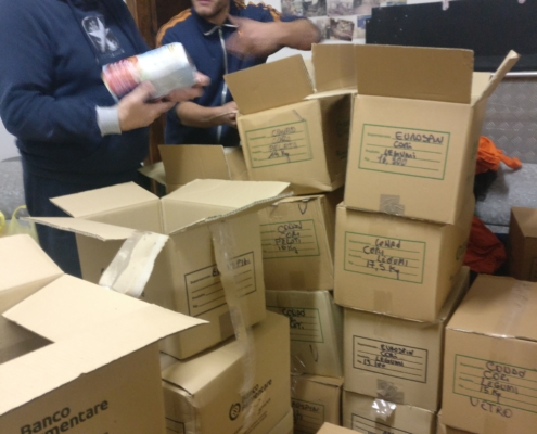 volunteers organising a food bank service for marginalised people