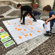 kids are coding on a board game without using robots