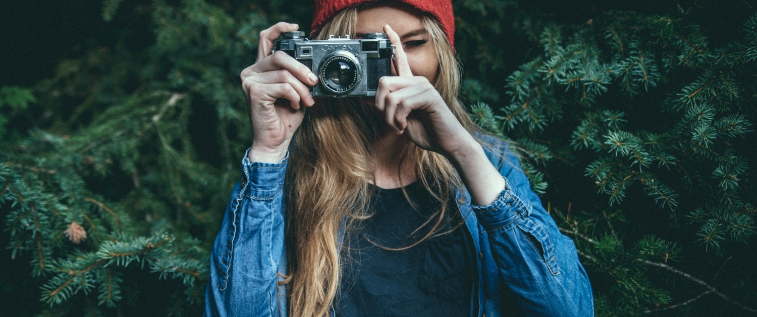 Woman with camera taking a picture